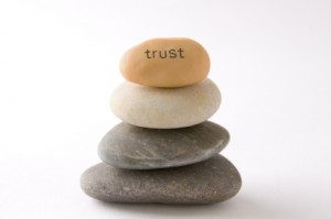 "Pile of stones with ""trust"" written on top one"